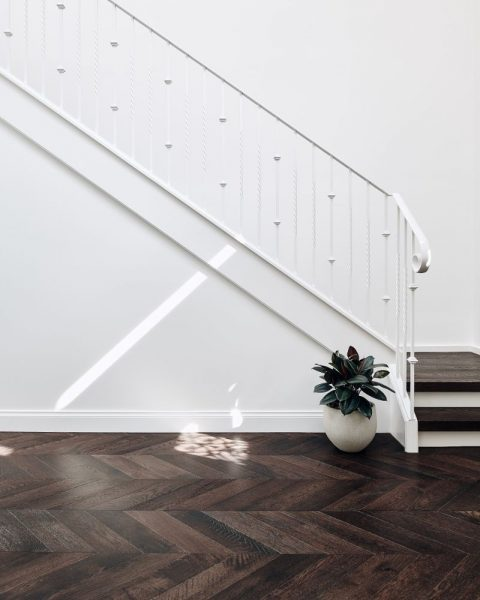 dark timber flooring with herringbone pattern
